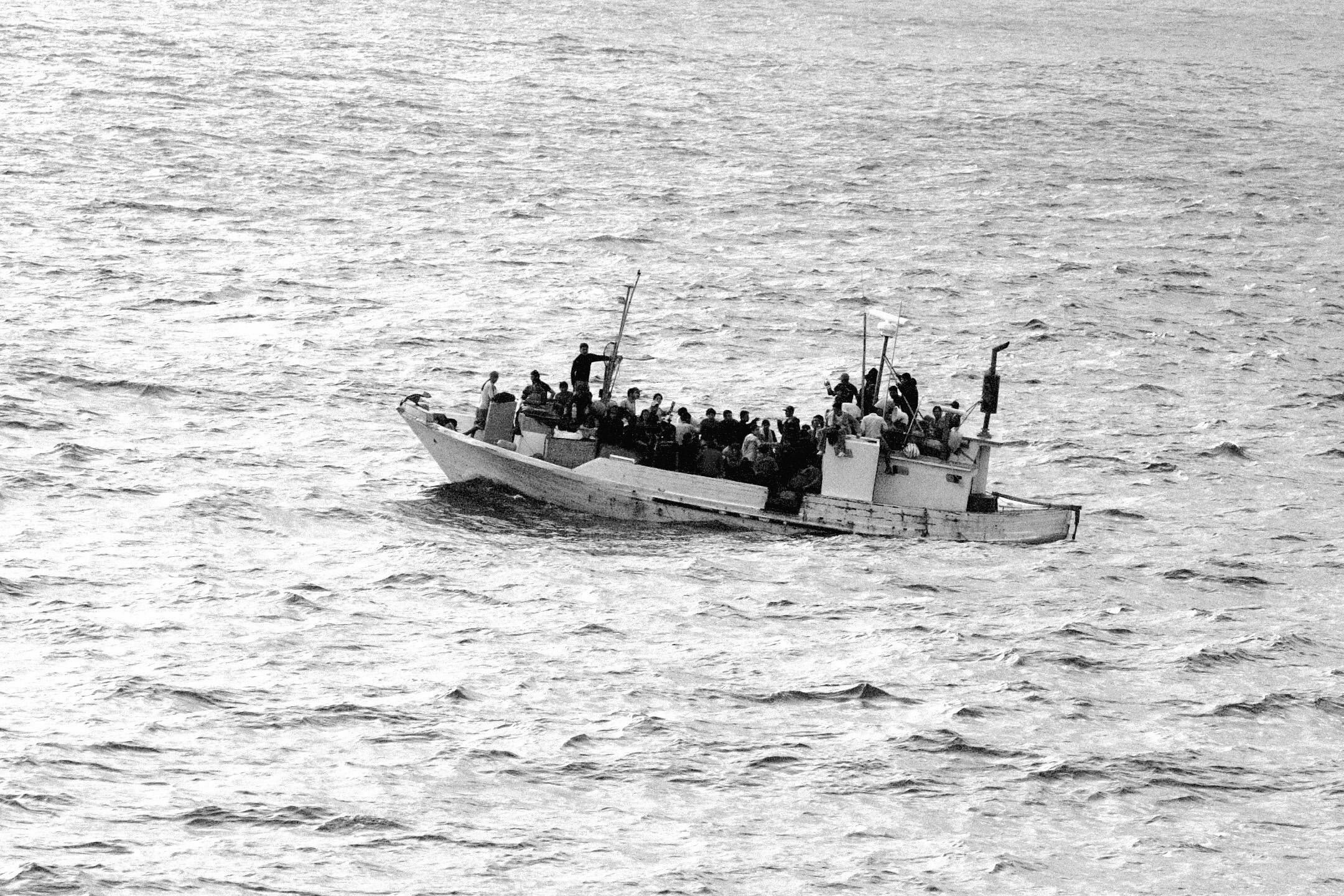 Un bateau rempli de migrant•e•s